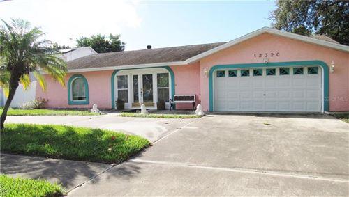 Photo of 12320 90TH AVENUE, SEMINOLE, FL 33772 (MLS # U8099612)