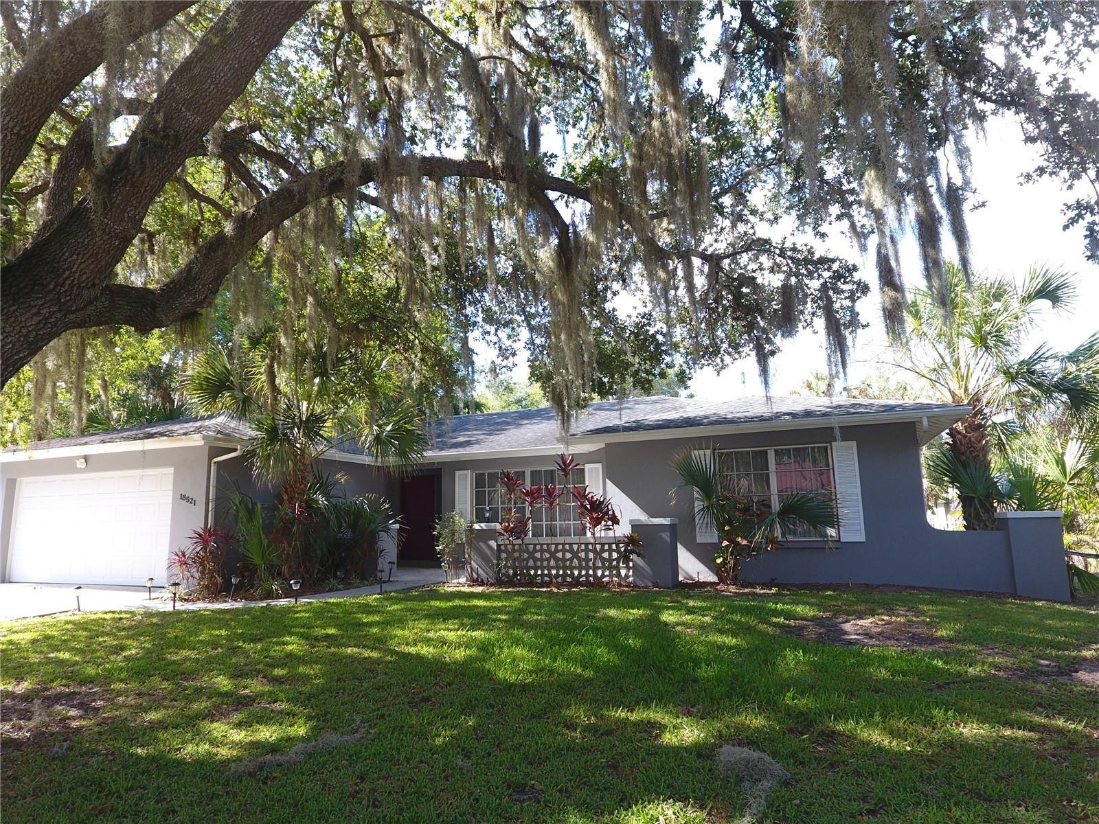 Photo of 18521 GRAND AVENUE, PORT CHARLOTTE, FL 33948 (MLS # C7444621)