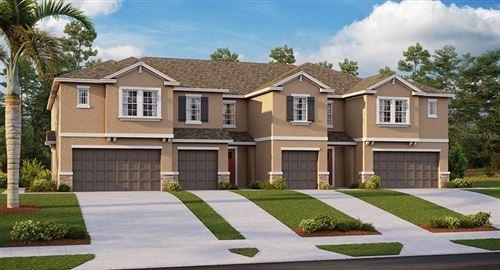 Photo of 32043 BLUE PASSING LOOP, WESLEY CHAPEL, FL 33545 (MLS # T3259622)