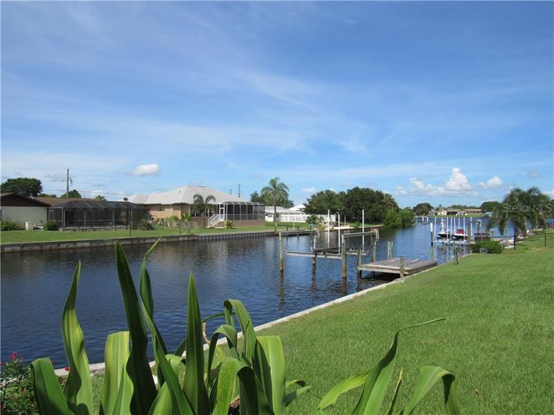 Photo of 189 N WATERWAY DRIVE NW, PORT CHARLOTTE, FL 33952 (MLS # C7431623)