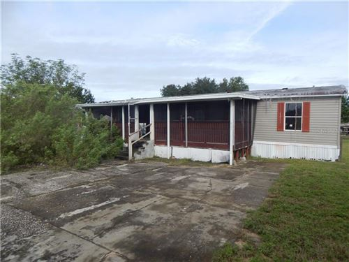 Photo of 824 MYSTERY HOUSE ROAD, DAVENPORT, FL 33837 (MLS # L4912625)