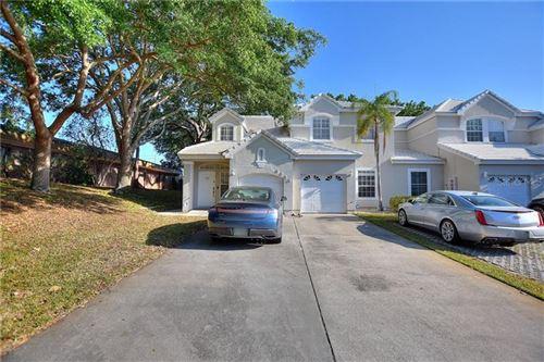 Photo of 6954 DELLA DRIVE #38, ORLANDO, FL 32819 (MLS # O5936630)