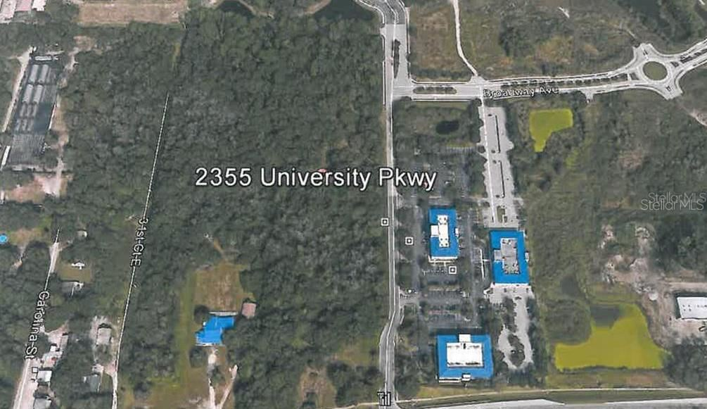 Photo of 2355 UNIVERSITY PARKWAY, SARASOTA, FL 34243 (MLS # A4178638)
