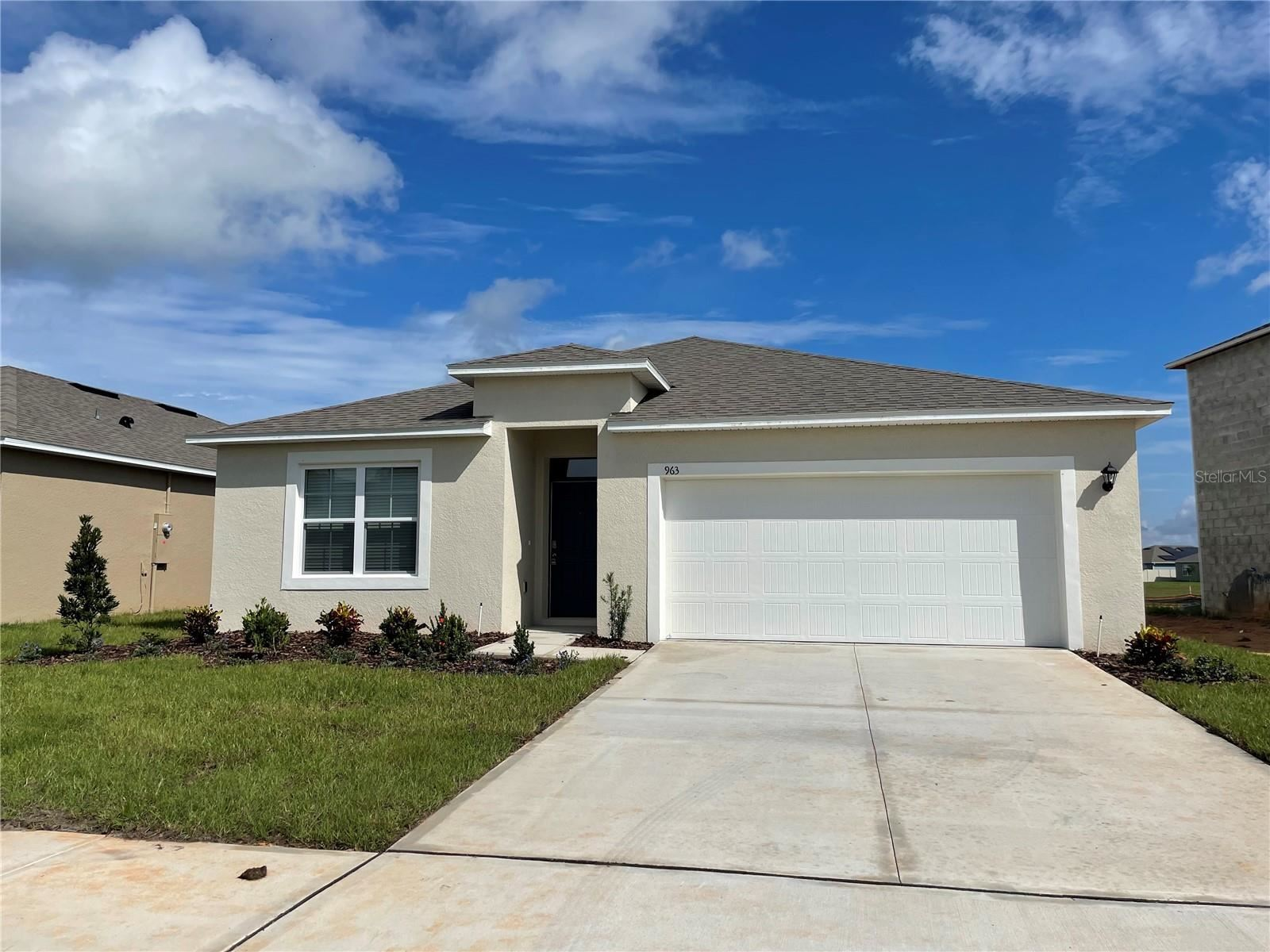 Photo of 936 BROOKLET DRIVE, HAINES CITY, FL 33844 (MLS # O5975639)