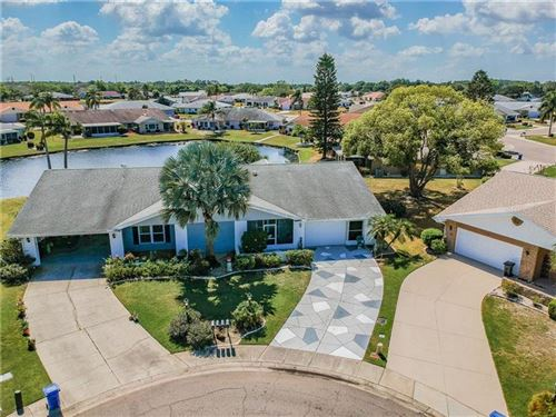 Photo of 1004 YELLOWBIRD PLACE, SUN CITY CENTER, FL 33573 (MLS # T3233642)