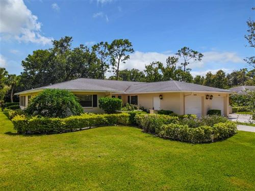 Photo of 5456 FAIRWAY BEND DRIVE, SARASOTA, FL 34243 (MLS # A4480644)