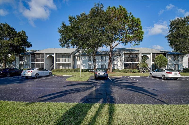 1127 PINE RIDGE CIRCLE W #E2, Tarpon Springs, FL 34688 - #: U8101657