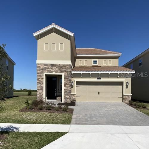 Photo of 1033 BLACKWOLF RUN ROAD, CHAMPIONS GATE, FL 33896 (MLS # O5848659)