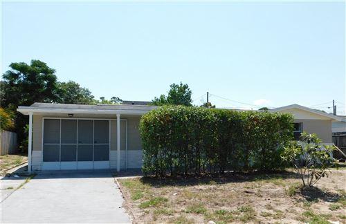 Photo of 12702 COLLEGE HILL DRIVE, HUDSON, FL 34667 (MLS # T3319665)