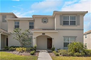 Photo of 9033 DOGLEG DRIVE, CHAMPIONS GATE, FL 33896 (MLS # O5785666)