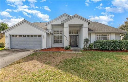 Photo of 10764 OAK GLEN CIR, ORLANDO, FL 32817 (MLS # O5915669)