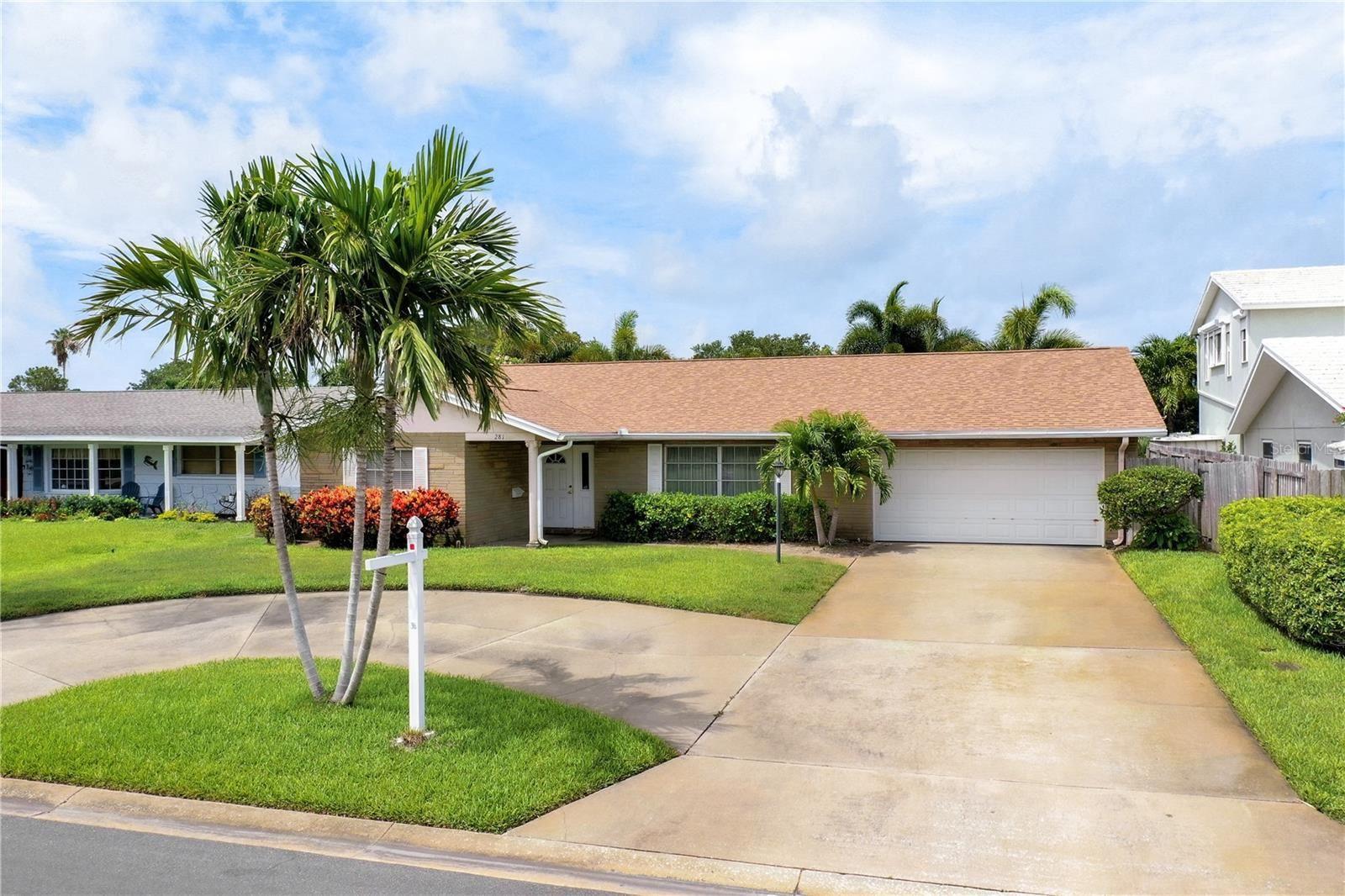Photo of 281 N JULIA CIRCLE, ST PETE BEACH, FL 33706 (MLS # U8125671)