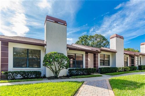 Photo of 3551 MAGNOLIA RIDGE CIRCLE #702, PALM HARBOR, FL 34684 (MLS # U8102674)
