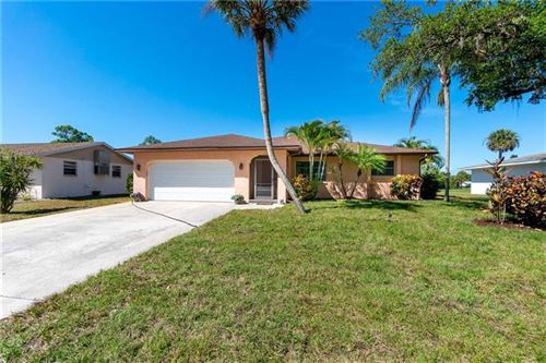 Photo of 28 OAKLAND HILLS PLACE, ROTONDA WEST, FL 33947 (MLS # D6111676)