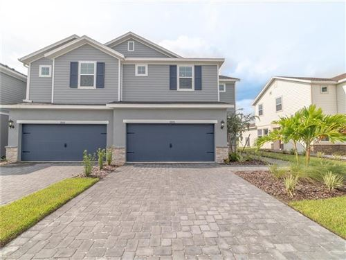 Photo of 11606 WOODLEAF DRIVE, LAKEWOOD RANCH, FL 34212 (MLS # O5826679)