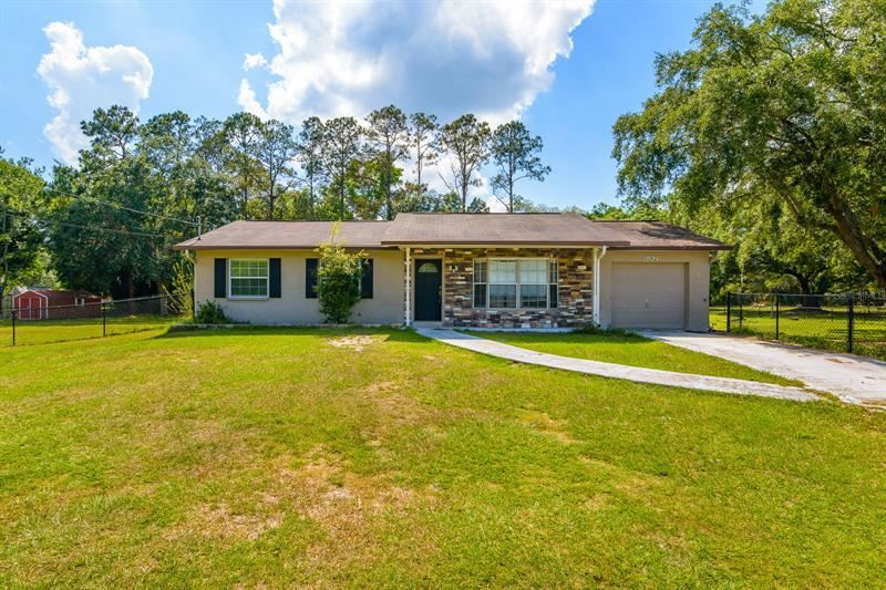Photo of 6062 COUNTRY CLUB ROAD, WESLEY CHAPEL, FL 33544 (MLS # U8122685)