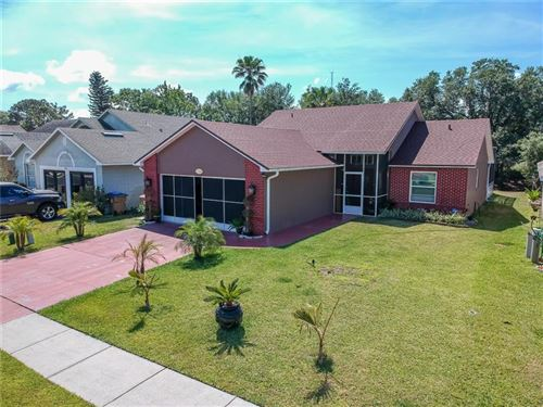Photo of 750 COUNTRY WOODS CIRCLE, KISSIMMEE, FL 34744 (MLS # O5943688)