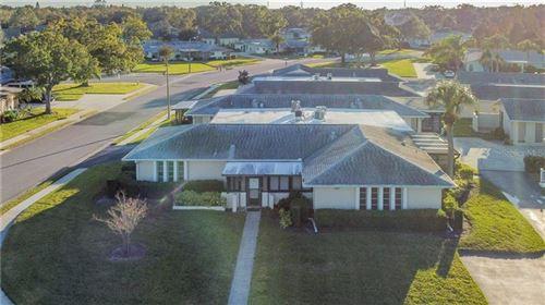 Photo of 2836 HIGHLANDS BOULEVARD #B, PALM HARBOR, FL 34684 (MLS # U8104688)