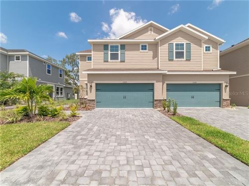 Photo of 11605 WOODLEAF DRIVE, LAKEWOOD RANCH, FL 34212 (MLS # O5826691)