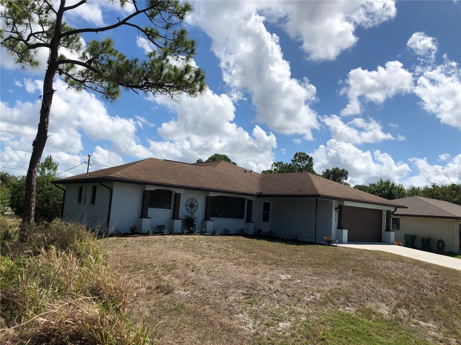 Photo of 534 FAIRVIEW AVENUE NW, PORT CHARLOTTE, FL 33952 (MLS # C7444694)
