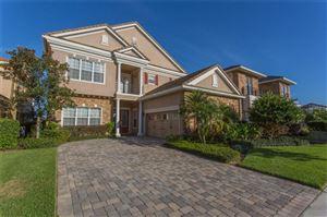 Photo of 311 MUIRFIELD LOOP, REUNION, FL 34747 (MLS # O5703697)