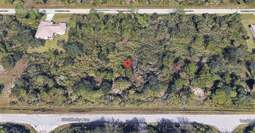 Photo of 13132 DOUBLEDAY AVENUE, PORT CHARLOTTE, FL 33953 (MLS # C7435698)