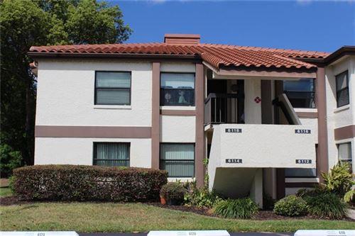 Photo of 6114 BURNSIDE CIRCLE #101, ORLANDO, FL 32822 (MLS # O5934699)