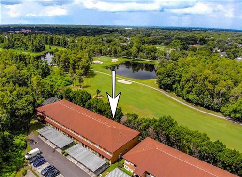 Photo of 14718 PAR CLUB CIRCLE #14718, TAMPA, FL 33618 (MLS # U8093701)