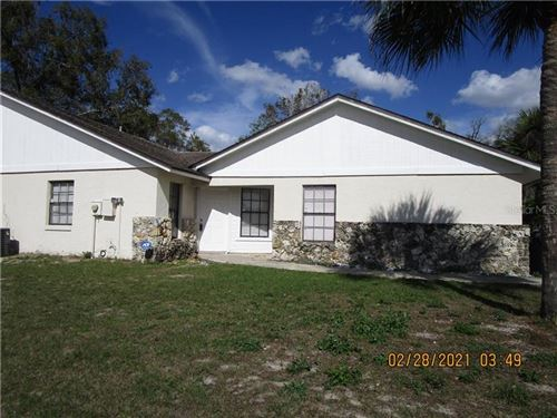 Photo of 4599 POINT LOOK OUT ROAD, ORLANDO, FL 32808 (MLS # O5893703)