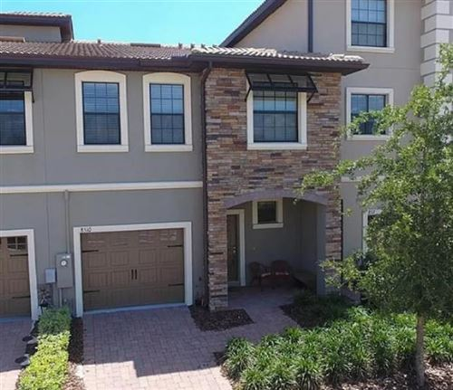 Photo of 8510 PLAYER POINT DRIVE, CHAMPIONS GATE, FL 33896 (MLS # T3300705)
