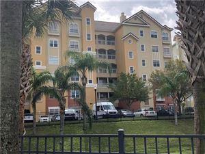 Photo of 8755 THE ESPLANADE #108, ORLANDO, FL 32836 (MLS # O5565708)