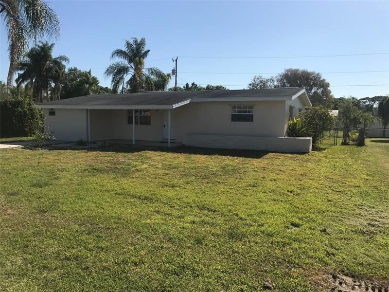 Photo of 1392 PINE AVENUE, NORTH FORT MYERS, FL 33917 (MLS # T3303711)