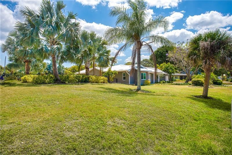 Photo of 1661 NEW POINT COMFORT ROAD, ENGLEWOOD, FL 34223 (MLS # D6117712)