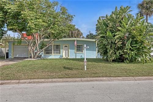 Photo of 5 HARBOR CIRCLE, COCOA BEACH, FL 32931 (MLS # O5848713)
