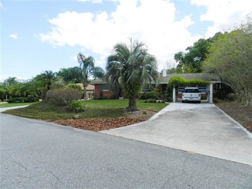 Photo of 115 E CYPRESS AVENUE, HOWEY IN THE HILLS, FL 34737 (MLS # O5854715)