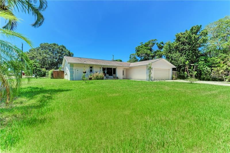 Photo of 4711 21ST AVENUE W, BRADENTON, FL 34209 (MLS # A4470715)