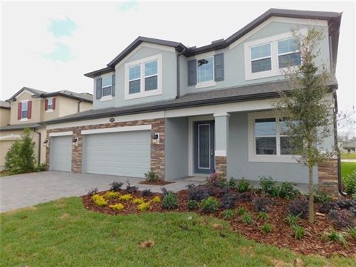 Photo of 1834 LEAF FLOWER LANE, LUTZ, FL 33558 (MLS # J924723)