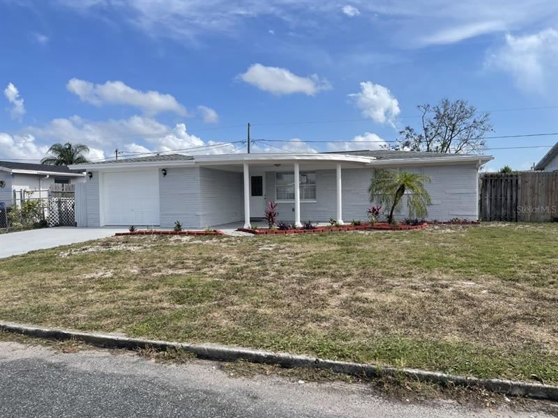 Photo of 3844 ELMWOOD DRIVE, HOLIDAY, FL 34691 (MLS # T3305728)