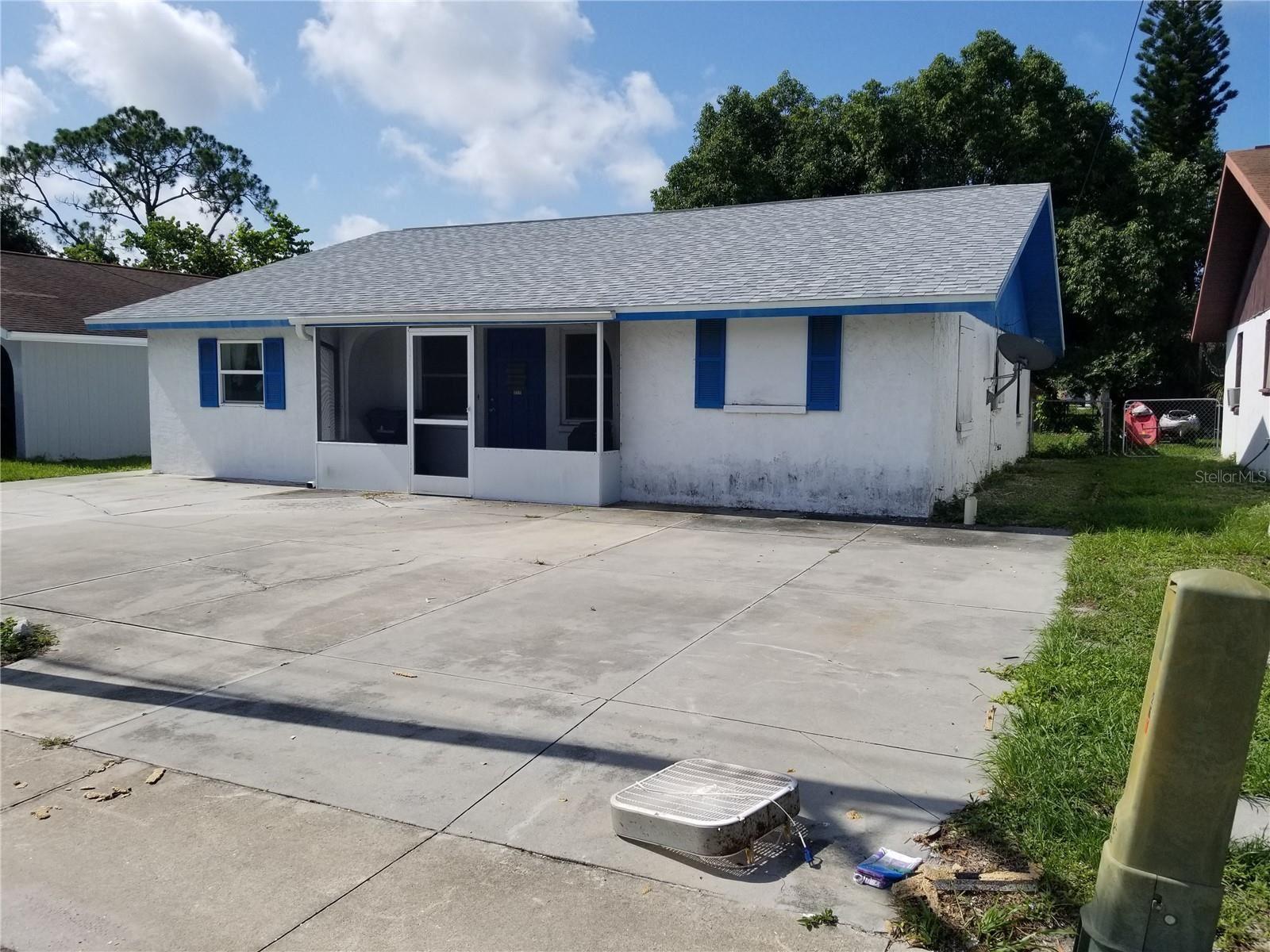 Photo of 261 E DEARBORN STREET, ENGLEWOOD, FL 34223 (MLS # C7445729)