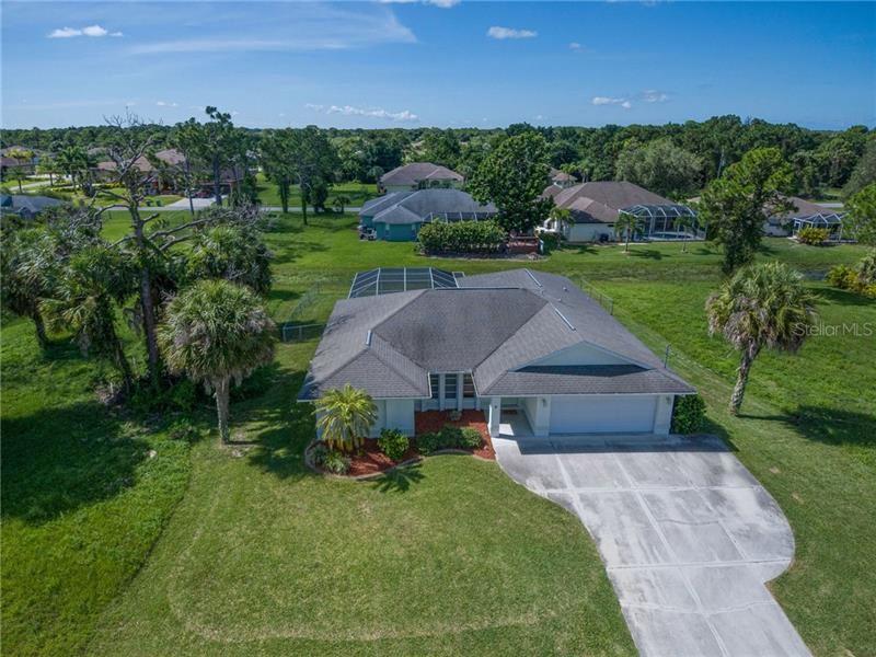 Photo of 8 PAR VIEW ROAD, ROTONDA WEST, FL 33947 (MLS # D6112731)