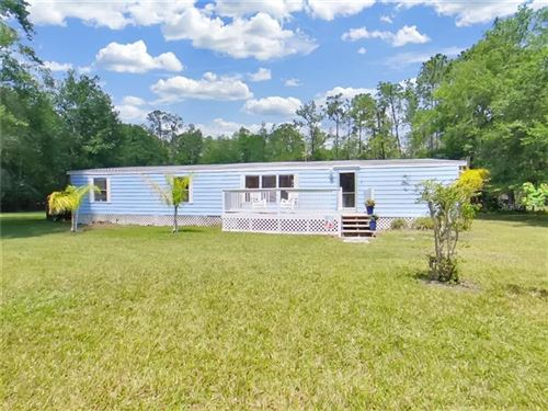Main image for 1507 WILDWOOD LANE, LUTZ, FL  33558. Photo 1 of 35