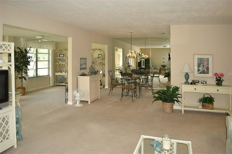 Photo of 3518 VILLAGE GREEN DRIVE #501, SARASOTA, FL 34239 (MLS # A4478735)