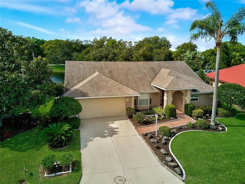 Photo of 5758 CARRIAGE DRIVE, SARASOTA, FL 34243 (MLS # A4481735)