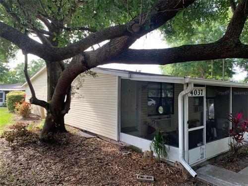 Photo of 4037 E MICHIGAN STREET #4037, ORLANDO, FL 32812 (MLS # O5940736)