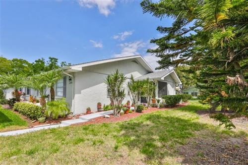 Photo of 2209 GREENHAVEN DRIVE, SUN CITY CENTER, FL 33573 (MLS # T3233737)