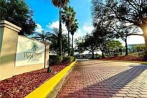 Photo of 4748 WALDEN CIRCLE #33, ORLANDO, FL 32811 (MLS # O5933738)