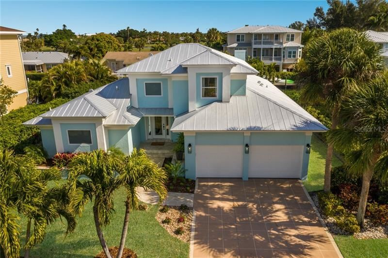Photo of 610 N NORTH POINT DRIVE, HOLMES BEACH, FL 34217 (MLS # A4459738)