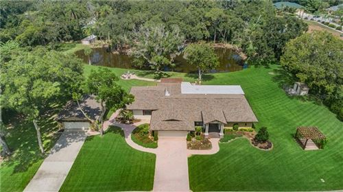 Photo of 1390 SUNRAY DRIVE, PALM HARBOR, FL 34683 (MLS # U8085745)