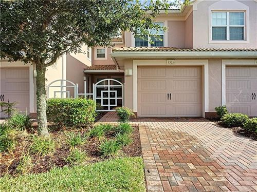 Photo of 8323 BELLA VIDA CIRCLE, CHAMPIONS GATE, FL 33896 (MLS # O5874758)