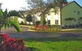 Photo of 4239 PERSHING POINTE PLACE #8, ORLANDO, FL 32822 (MLS # O5826762)